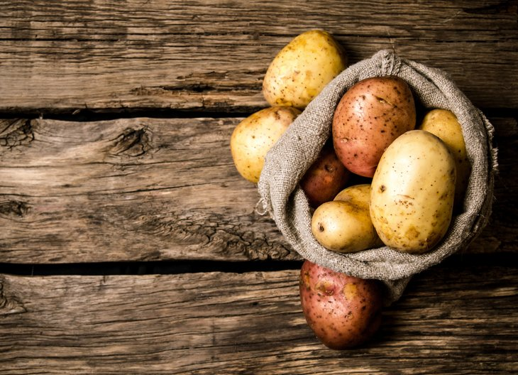 Potatoes on a wood table
