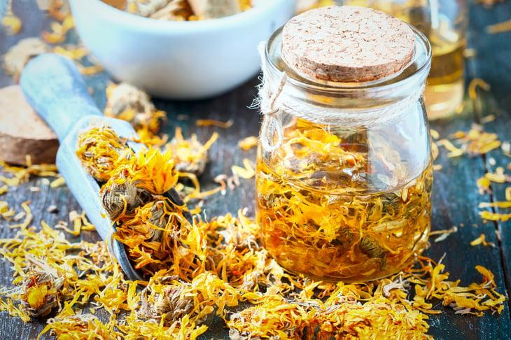 Yellow calendula flowers in a jar.