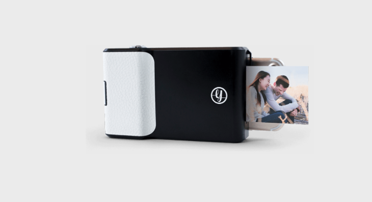 Prynt camera with photo emerging from side.