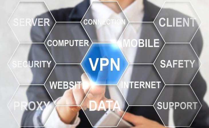 Man in suit pressing virtual VPN button