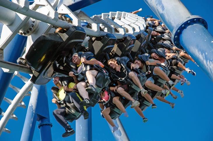 People upside down on amusement park ride.