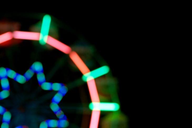 Blur of amusement park lights at night.