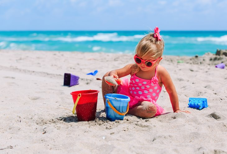 Basic beach toys can be found at most dollar stores at low prices - and offer lots of fun.