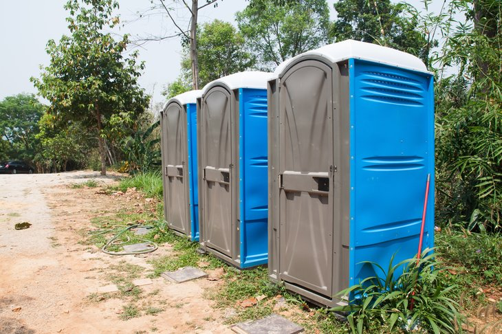 Three portable toilet units in a row.