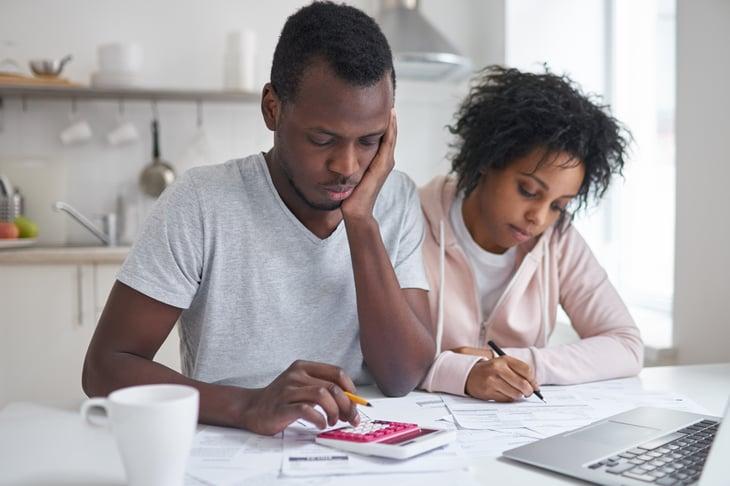Black couple budgeting together