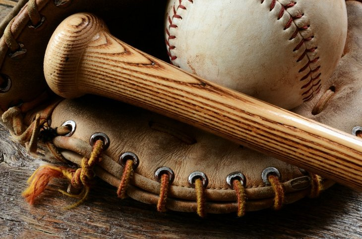Baseball mitt, bat and ball.