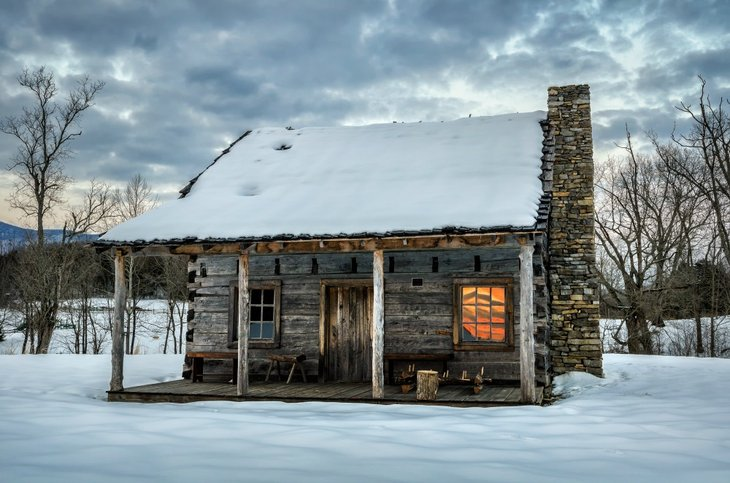 Old homestead house in snow.