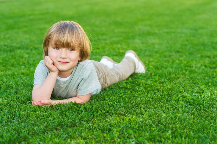 Child on green lawn