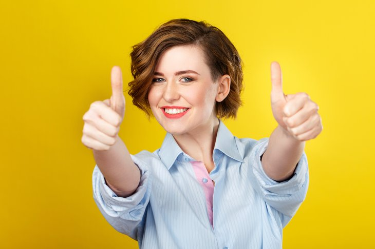 Young woman with two thumbs up.
