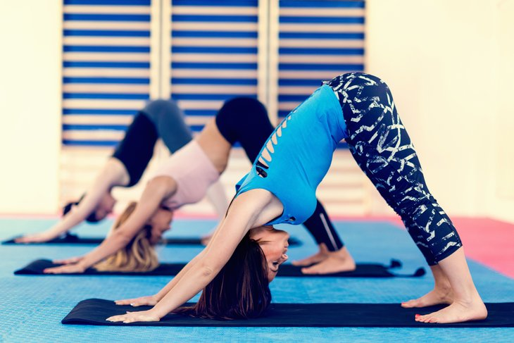 Yoga participants in downward dog position.
