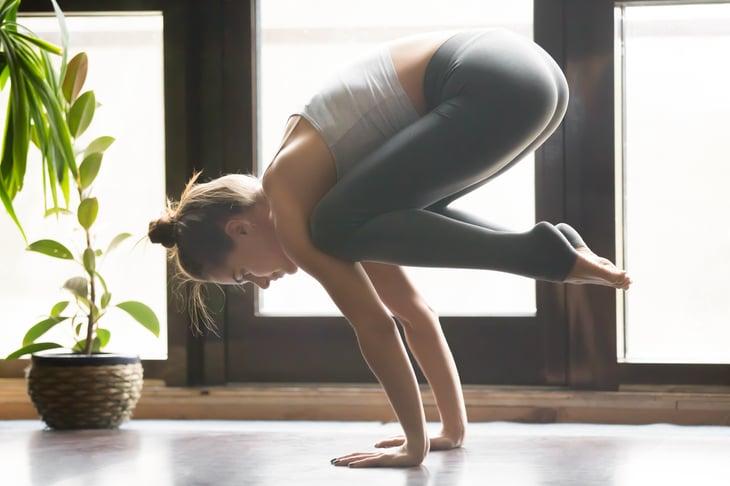 Yoga practitioner in crane position.