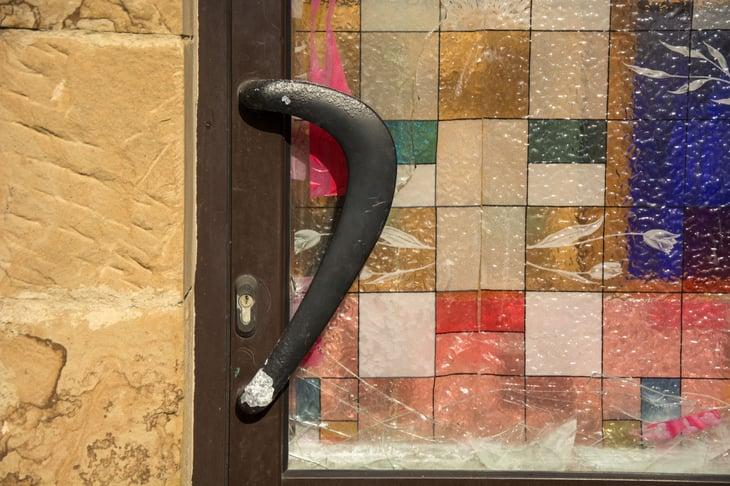 Unusual brass door handle with colored door.