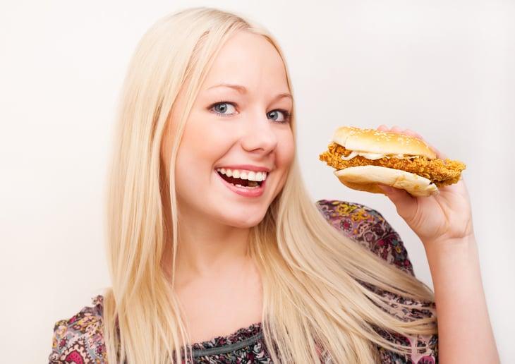 Woman with chicken sandwich