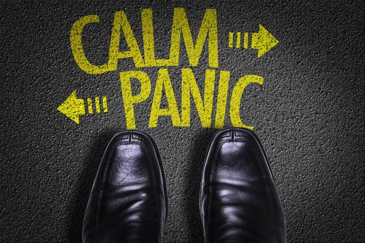 Calm/panic written on sidewalk by shoes
