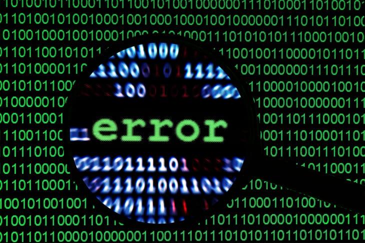 "Computer code ""error"" viewed through magnifying glass."