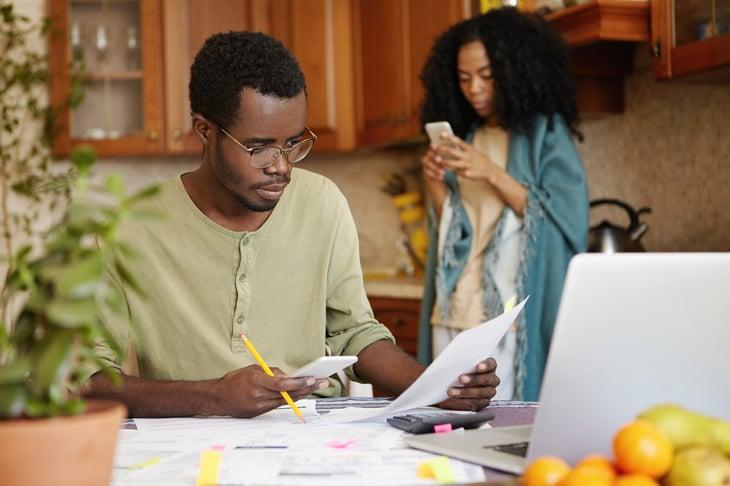 African American couple doing bills.