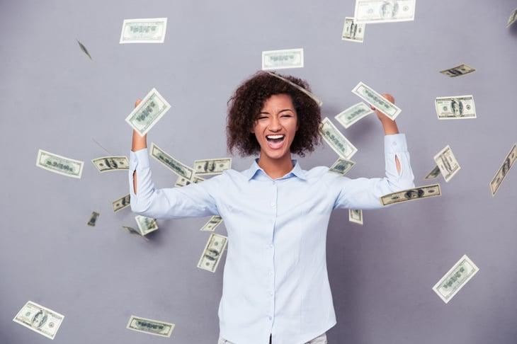 Happy woman amid falling cash.
