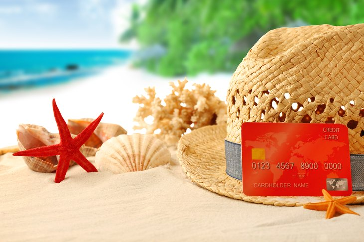 Credit card on beach with hat and starfish