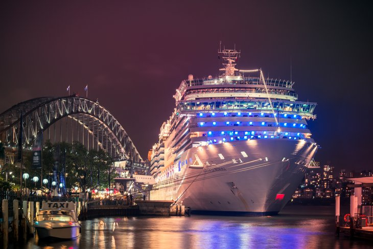 Cruise ship docked at night.