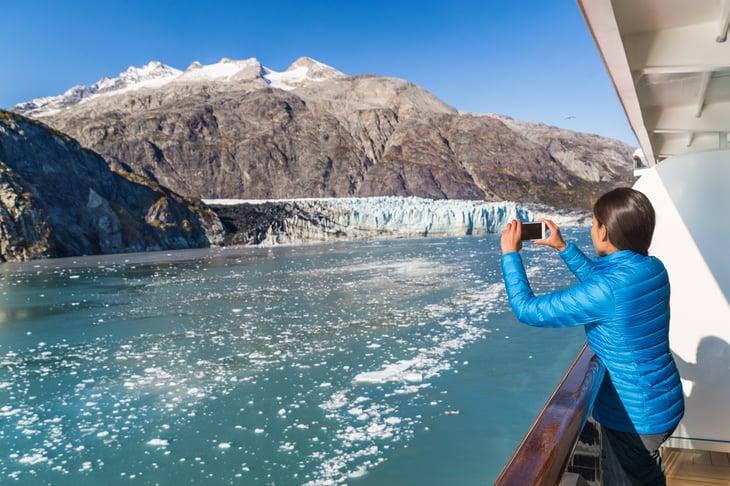 Alaska cruise ship passenger taking a picture.