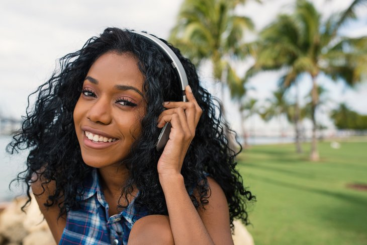 Teenager listening to music on headphones