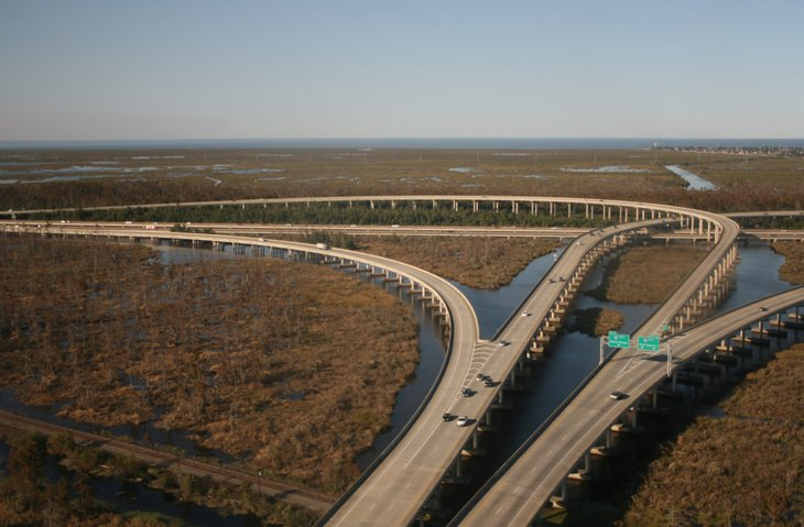 Aerial view of interstate highway over Louisiana bayou.