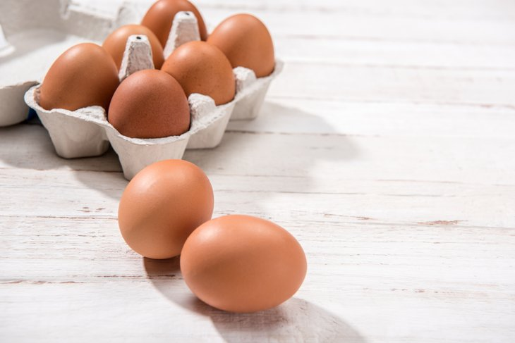 Brown eggs on a table top.
