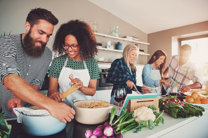 Group of people cooking.