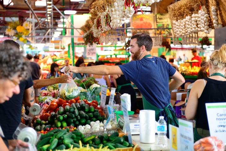 Busy farmers market scene.