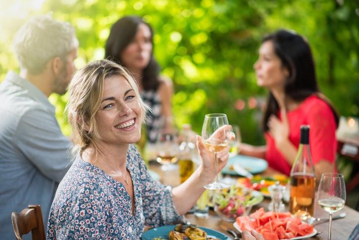 Happy women having dinner outside.