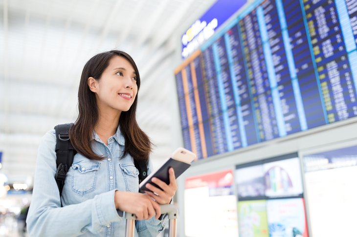 Young Asian woman in airport.