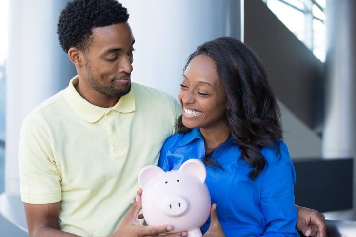 Happy couple with money