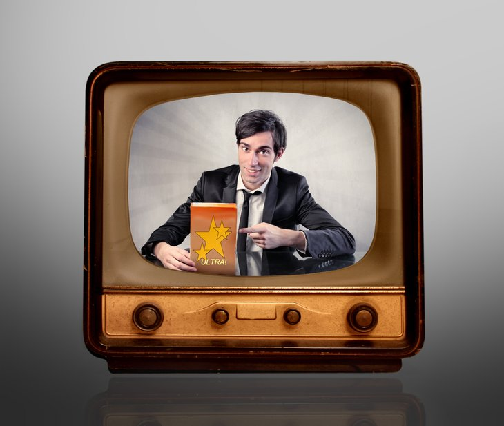 Salesman shown on old-fashioned TV set.