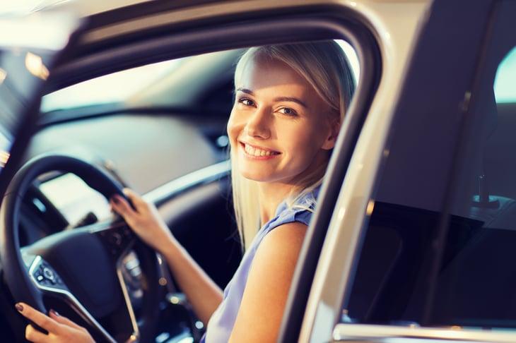Woman in car.