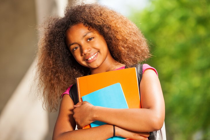 Young woman clutching books.