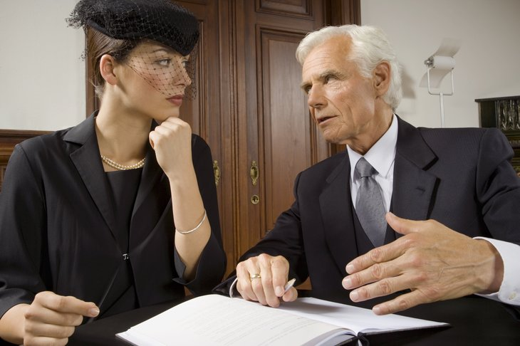 Woman with widow's veil talking to lawyer