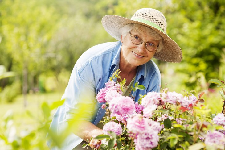 Retired woman gardening