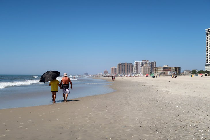 Couple walking on beach in Atlantic City.