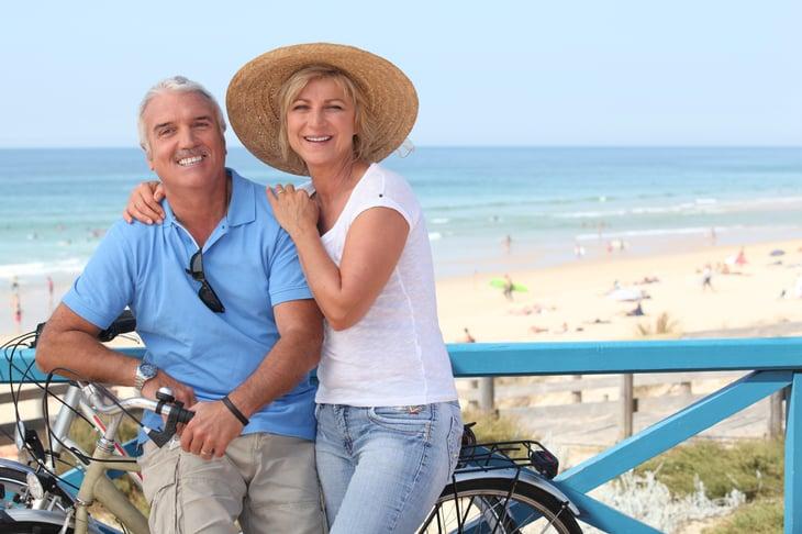 Couple with bike near seashore