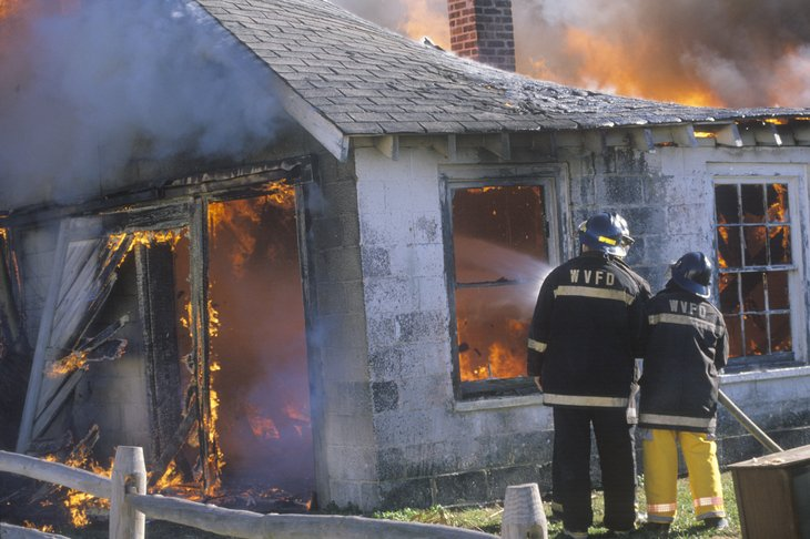 Firefighters putting out a fire