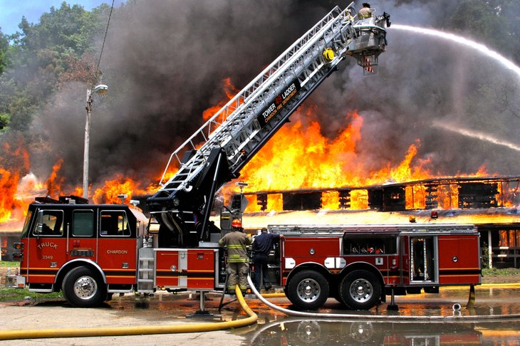 PAINESVILLE - OCTOBER 15: Firefighters fighting fire during training on October 15, 2009 in Painesville, Ohio - Image