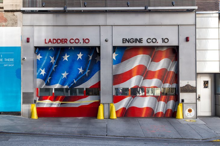 New York, United States of America - November 18, 2016: FDNY Engine 10 and Ladder 10 Firehouse across from World Trade Center site and the 9-11 Memorial in Manhattan