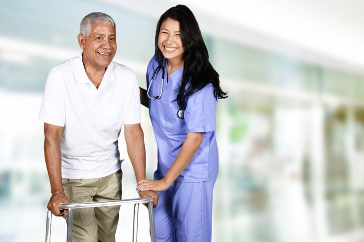 Senior health care pictured by a man with a walker and a nurse