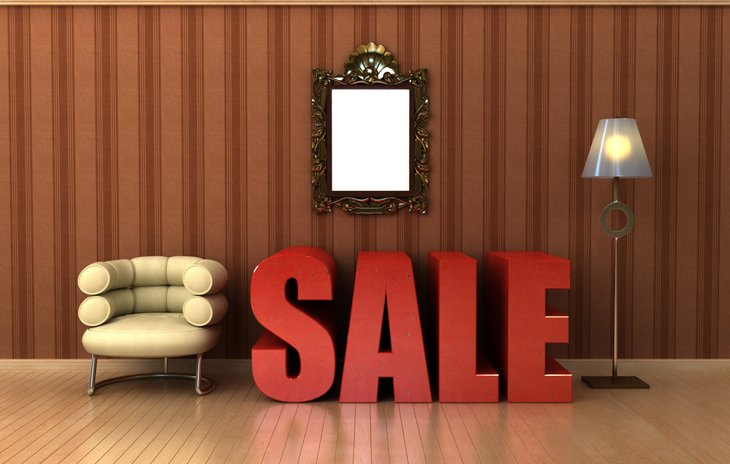 Sale sign with mirror and chair.