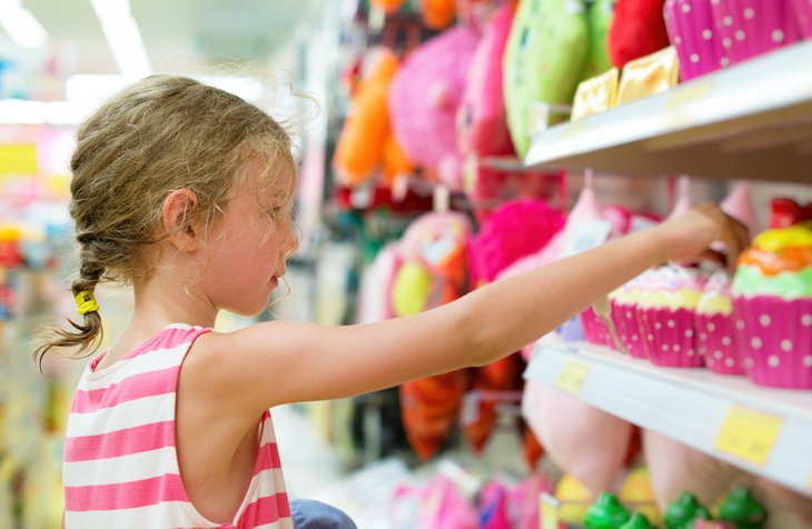 Girl selecting toys