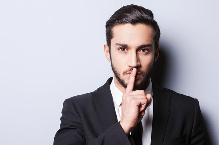 Businessman gesturing quiet