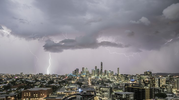 Storm gathering over large city.