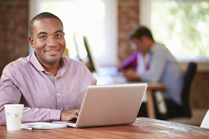 Black man working on a laptop