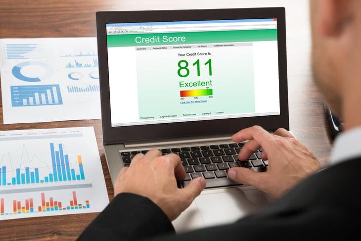 A man checking credit score on a laptop