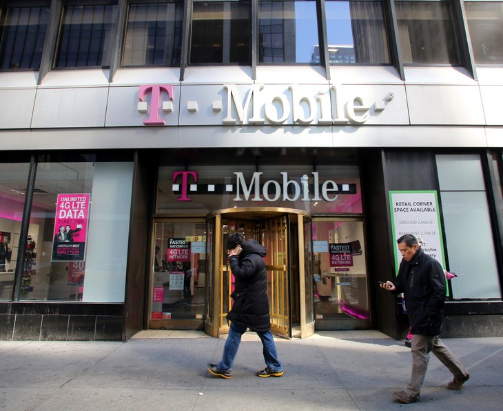 T-Mobile store front and pedestrians.